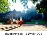 family visiting ancient preah... | Shutterstock . vector #619484006
