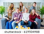 friends watching tv | Shutterstock . vector #619504988