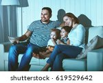 family watching television at... | Shutterstock . vector #619529642