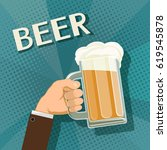 human hand holds a mug of beer. ... | Shutterstock .eps vector #619545878