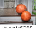 Two Pumpkins On Wooden Porch...