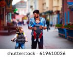 happy father and two sons on... | Shutterstock . vector #619610036