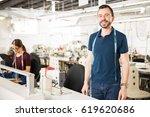 good looking young man working... | Shutterstock . vector #619620686