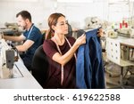 attractive young seamstress... | Shutterstock . vector #619622588