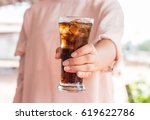 woman hand giving glass of cola.... | Shutterstock . vector #619622786