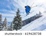 good skiing in the snowy... | Shutterstock . vector #619628738