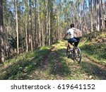 a biker man goes to the forest... | Shutterstock . vector #619641152