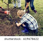 group of people plant a tree... | Shutterstock . vector #619678622