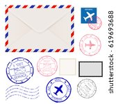 airmail envelope with postmarks.... | Shutterstock .eps vector #619693688