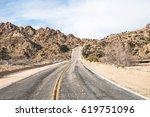 endless road in joshua tree...   Shutterstock . vector #619751096