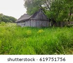 old wooden barn among trees and ... | Shutterstock . vector #619751756