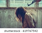 a woman is about to be shot... | Shutterstock . vector #619767542