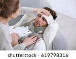 young woman taking care of ill... | Shutterstock . vector #619798316
