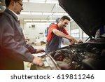 car mechanics working on car...   Shutterstock . vector #619811246