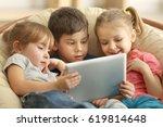 cute kids using digital tablet | Shutterstock . vector #619814648
