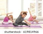 group of children doing... | Shutterstock . vector #619814966