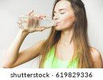 healthy woman drinks water | Shutterstock . vector #619829336