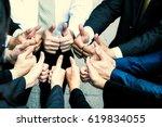 businessmen showing thumbs up   ...   Shutterstock . vector #619834055