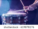 man plays musical percussion... | Shutterstock . vector #619878176