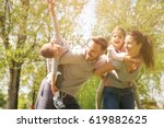 parents playing with their... | Shutterstock . vector #619882625