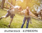 parents playing with their... | Shutterstock . vector #619883096