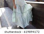 fashionable woman in long dress ... | Shutterstock . vector #619894172