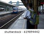 an asian young man carrying a... | Shutterstock . vector #619894442