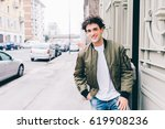 waist up of handsome young man... | Shutterstock . vector #619908236
