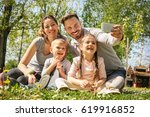 happy family smiling while... | Shutterstock . vector #619916852