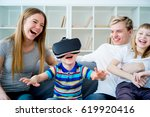 family playing with virtual...   Shutterstock . vector #619920416
