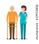 young female nurse helping... | Shutterstock .eps vector #619923806