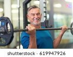 mature man in health club  | Shutterstock . vector #619947926