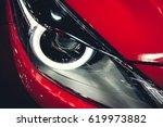 headlight of a modern luxury... | Shutterstock . vector #619973882