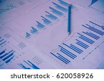 many charts and graphs with pen ... | Shutterstock . vector #620058926