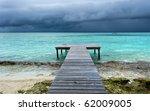 Wooden Bridge On Beach Extende...
