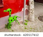 Painted Dog Figure In Green In...