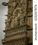 Small photo of Gargoyles and Saints on façade on Siena Cathedral