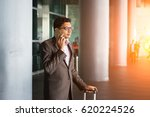 indian male walking at airport     Shutterstock . vector #620224526
