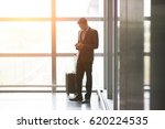 indian male walking at airport   | Shutterstock . vector #620224535