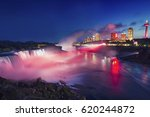 Small photo of Night at Niagara Falls And American Falls with Colorful Lights, New York State, USA