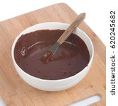 chocolate frosting in a white... | Shutterstock . vector #620245682
