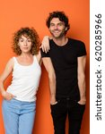 funny young couple on orange... | Shutterstock . vector #620285966