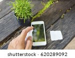 cleaning smart phone screen | Shutterstock . vector #620289092