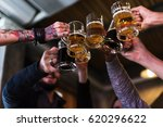 hands hold beverage beers... | Shutterstock . vector #620296622