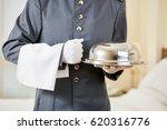 hotel clerk serving food with... | Shutterstock . vector #620316776