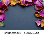 frame of dry rose petals on a...   Shutterstock . vector #620320655