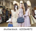three women shopping together... | Shutterstock . vector #620364872