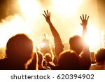 cheering crowd at a rock... | Shutterstock . vector #620394902