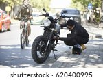 a motorist having problems with ...   Shutterstock . vector #620400995