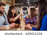 friends play table games at the ... | Shutterstock . vector #620411126